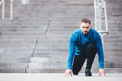 Sportsman in a starting position, ready to run. Active lifestyle. Sport Royalty Free Stock Image
