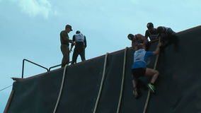 Sportsman storms big wall in extrim race. Tyumen stock footage