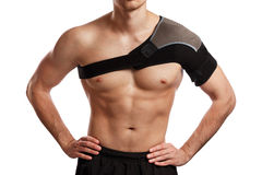 Sportsman with a support bandage on his shoulder Stock Image