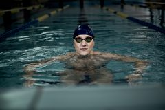 Sportsman in swimming pool Stock Image