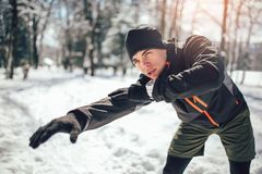 Sportsman Taking Break From Running in Extreme Snow Conditions. Man Sportsman Taking Break From Running in Extreme Snow Conditions Stock Images