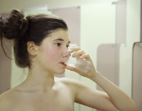 Sportsman teen girl drink water from plastic glass Stock Photo