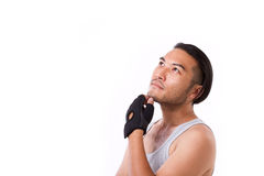 Sportsman thinking, looking up Royalty Free Stock Photography
