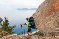 Sportsman on the top of rock. Sport and active Royalty Free Stock Photography