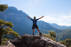 Sportsman on the top of rock. Sport and active Royalty Free Stock Image