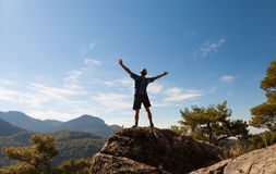 Sportsman on the top of rock. Sport and active Stock Photos