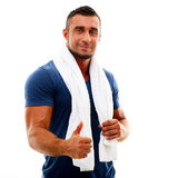 Sportsman with towel showing thumb up Stock Photography