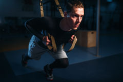 Sportsman on training,endurance workout with ropes Stock Photo