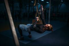 Sportsman on training,endurance workout with ropes Royalty Free Stock Photos