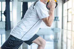 Sportsman training with resistance band in sports center Royalty Free Stock Photo