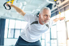 Sportsman training with resistance band in sports center Royalty Free Stock Photos