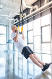 Sportsman training with resistance band in sports center Stock Photography