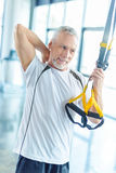 Sportsman training with resistance band in sports center Stock Photo