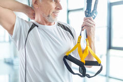 Sportsman training with resistance band in sports center Stock Photos