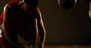 Sportsman tying his shoe lace. In basketball court 4k stock video