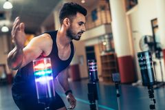 Sportsman using a visual stimulus system. Athlete using a visual stimulus system to improve reaction time. Sportsman at sports science lab exercising with lights Royalty Free Stock Photos