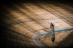 Sportsman at velodrome. Athlete with a bicycle at velodrome Stock Photo