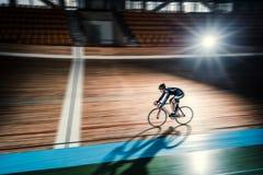 Sportsman on a velodrome. Athlete on a bicycle on velodrome Royalty Free Stock Photography
