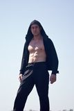 Sportsman witn naked chest in the hood royalty free stock image