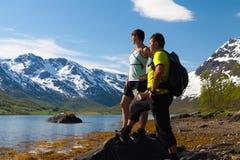 Sportsman and woman near mountain lake Stock Photos