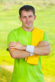 A sportsman with yellow cottton towel Stock Photos