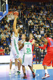 Sportsman from Zalgiris (Lithuania, in white) team throws ball Royalty Free Stock Photography
