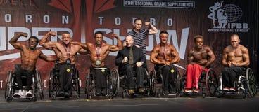 Sportsmannaanda av rullstolkroppsbyggare på Toronto 2018 pro-Supershow arkivbild