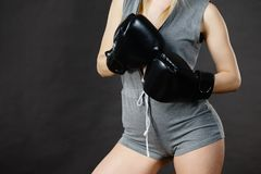 Boxer girl exercise with boxing gloves. Royalty Free Stock Images