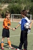 Sportsmanship handshake. Sportsmanship, shaking hands, children football Stock Image