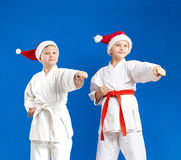 Sportsmen in the cap of Santa Claus are hitting blow arm Royalty Free Stock Image