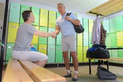 Sportsmen in cloak room after training Royalty Free Stock Image