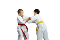 Sportsmen are doing paired exercises Judo. On the white background Royalty Free Stock Photography