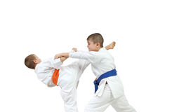 Sportsmen are doing paired exercises karate  on a white background Royalty Free Stock Photos