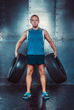Sportsmen. fit male trainer man keeps the car tires, concept crossfit fitness workout strenght power Stock Photos