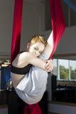 Sportsmen girl posing in fitness studio. Cute sportsmen girl posing on fitness studio Royalty Free Stock Image