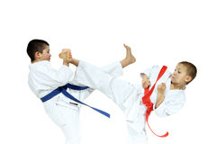 Sportsmen are hitting blows mae geri and yoko-geri Royalty Free Stock Image