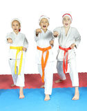 Sportsmen in the judogi and caps of Santa Claus are beating blows arms Royalty Free Stock Image