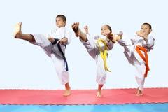 Sportsmen in karategi are beating direct kick leg Stock Photos