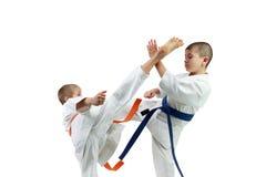Sportsmen in karategi are beating kick mawashi geri Royalty Free Stock Photo