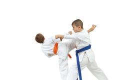 Sportsmen in karategi are doing paired exercises karate Royalty Free Stock Image