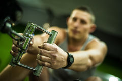 Sportsmen makes workout in training centre Royalty Free Stock Images