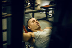 Sportsmen makes workout in training centre Royalty Free Stock Image