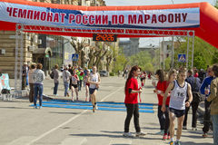 Sportsmen participants of the Volgograd marathon run through the finish line Royalty Free Stock Image