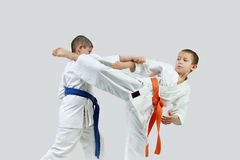 Sportsmen perform paired exercises karate Royalty Free Stock Photos