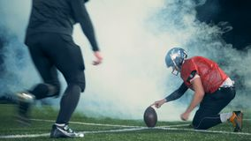 Sportsmen playing American football in smoke, back view. stock video