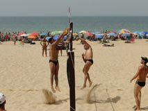 Sportsmen playing beach volleyball. Volleyball competition on the Andalusia beach from Spain. Young men playing volleyball on the beach. Volleyball player in Stock Photography