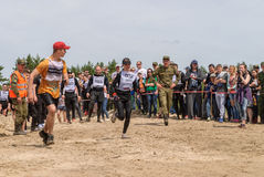 Sportsmen run on last stage in extrim race.Tyumen Royalty Free Stock Images