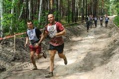 Sportsmen run between stages in extrim race.Tyumen Stock Photos