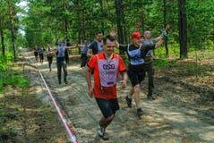 Sportsmen run between stages in extrim race.Tyumen Stock Image