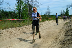 Sportsmen run between stages in extrim race.Tyumen Stock Images